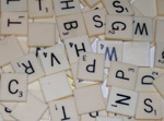 Photo of Ivory Colored white plastic Consonant Scrabble Letters