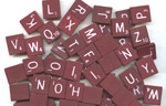 Photo of Maroon Consonant Scrabble Letters