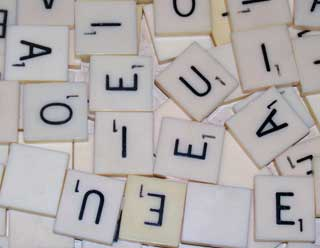 Photo of Ivory Colored white plastic Vowel Scrabble Letters
