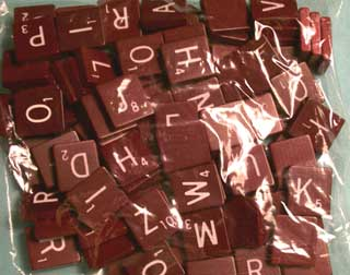 Photo of a complete set of Used Maroon Scrabble Letters