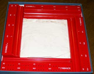 Photo of Red plastic scoring trays / letter racks