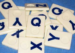 Photo of a group of Q, X, Y and Z Wordkub game pieces