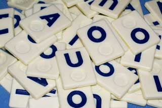 Photo of a group of vowels Wordkub game pieces