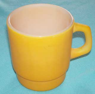 Photo of Fire King Stackable Yellow Coffee Cup - left side