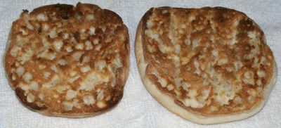 Photo showing one Muffin, cut in half and toasted. Ready for sauce and toppings.