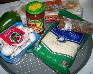 Photo showing all the ingredients, 'Makings', for Muffin Pizzas.