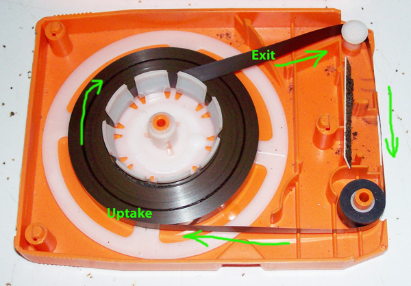 photo of an eight track tape's inside's.