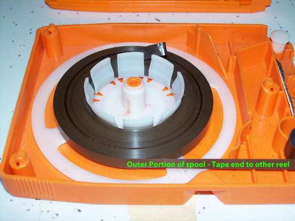 photo of an eight track tape's inside's showing the portion of tape that starts the unwinding process.