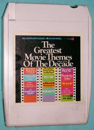 Photo of eight track quadraphonic tape cartridge - Greatest Movie Themes of the Decade, Enoch Light and the Light Brigade, 1964 to 1974 - front