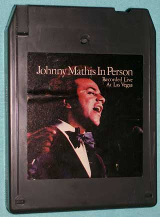 Photo of eight track quadraphonic tape cartridge - Johnny Mathis In Person - front