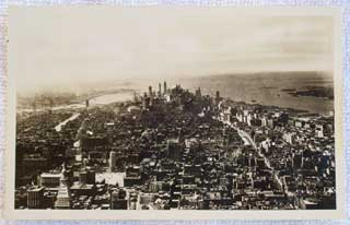 Photo of front of Real Photo postcard showing New York City, looking south from the top of the Empire State Building