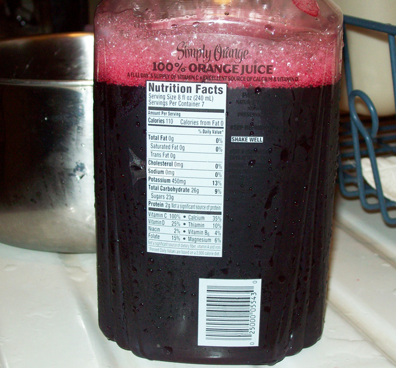 Photo of 5 cups of fresh crushed wild grape juice.