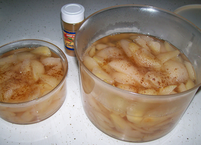 photo of wild pears all done and soaking in their sugared syrup - cinnamon added.