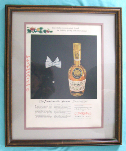 Photo of A 10 3/4 X 13 1/2 inch Old Smuggler Blended Scotch Whiskey Ad mounted in a Matted Frame - from a 1958 magazine
